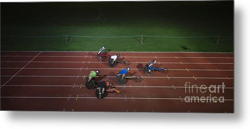 14-15 Years Metal Print featuring the photograph Paraplegic Athletes Racing Along Sports Track In Night by Caia Image/science Photo Library