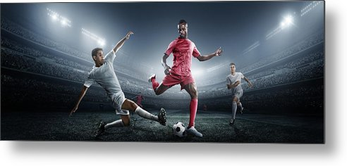 Soccer Uniform Metal Print featuring the photograph Soccer Player Kicking Ball In Stadium by Dmytro Aksonov