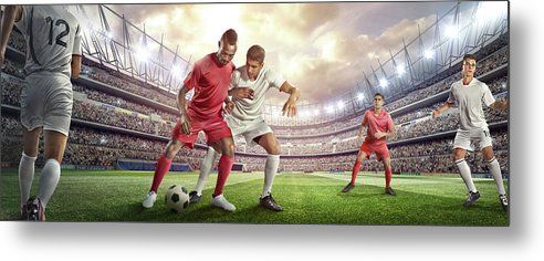 Soccer Uniform Metal Print featuring the photograph Soccer Player Tackling Ball In Stadium by Dmytro Aksonov
