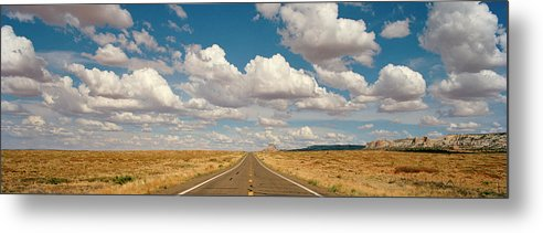 Scenics Metal Print featuring the photograph Desert Road With Cloud Formations Above by Gary Yeowell