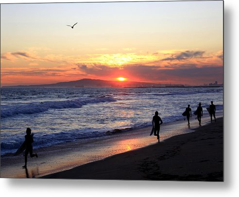 Surfers Metal Print featuring the photograph Surfers At Sunset by Frank Freni