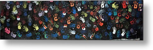 Child Metal Print featuring the photograph A Painting Of Colorful Handprints by Khananastasia