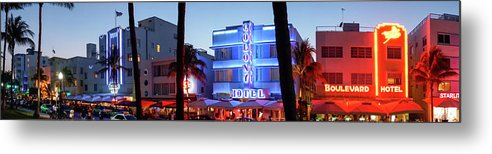 Panoramic Metal Print featuring the photograph Art Deco Hotels On Ocean Drive At Dusk by Buena Vista Images