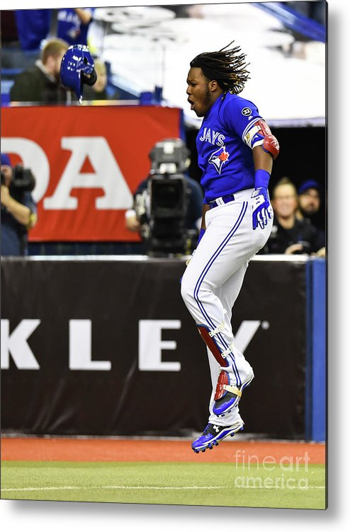 People Metal Print featuring the photograph St Louis Cardinals V Toronto Blue Jays 4 by Minas Panagiotakis