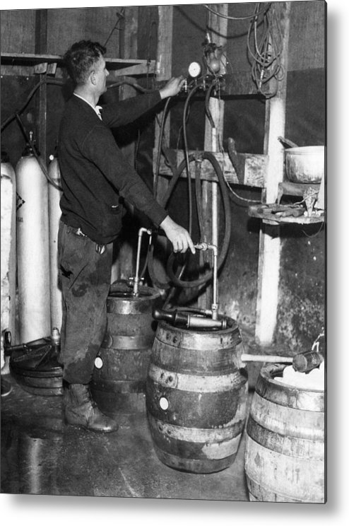 1930s Metal Print featuring the photograph A Brewmeister Fills Kegs At A Bootleg by Everett