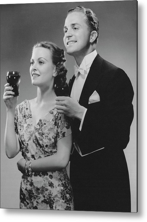 Heterosexual Couple Metal Print featuring the photograph Couple Dressed Up Holding Drinks by George Marks