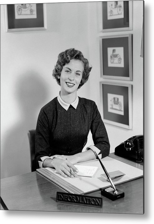 Photography Metal Print featuring the photograph 1950s Woman Sitting At Information Desk by Vintage Images
