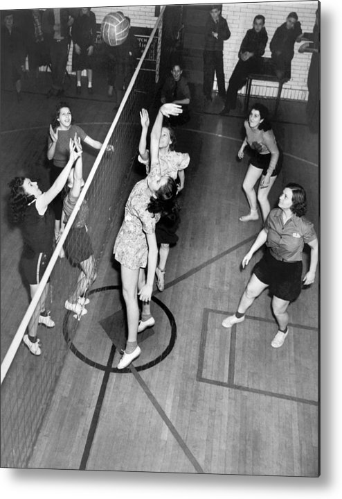 1949 Metal Print featuring the photograph Girls Playing Volleyball by Underwood Archives