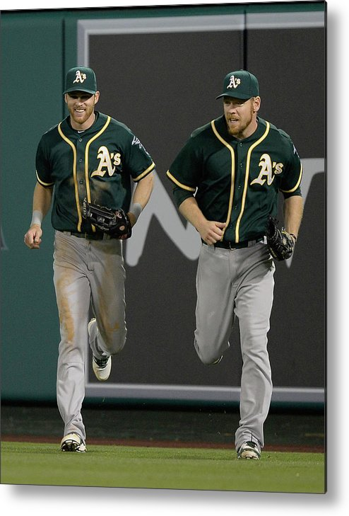 American League Baseball Metal Print featuring the photograph Derek Norris, Howie Kendrick, And Brandon Moss by Harry How
