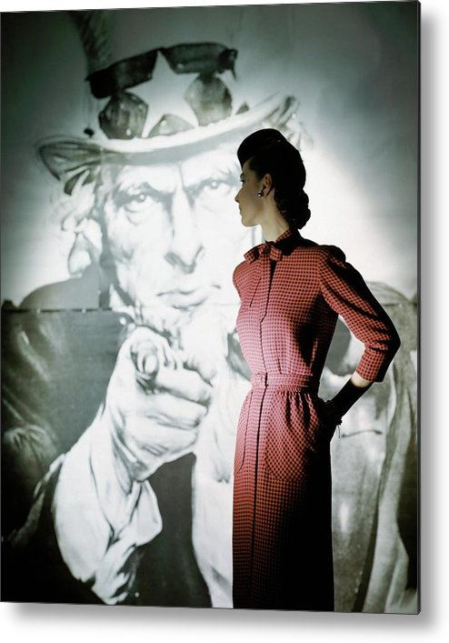 Fashion Metal Print featuring the photograph A Model Wearing A Checked Dress by John Rawlings