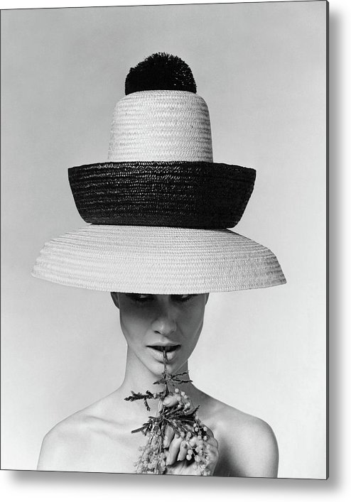 Accessories Metal Print featuring the photograph A Model Wearing A Sun Hat by Karen Radkai