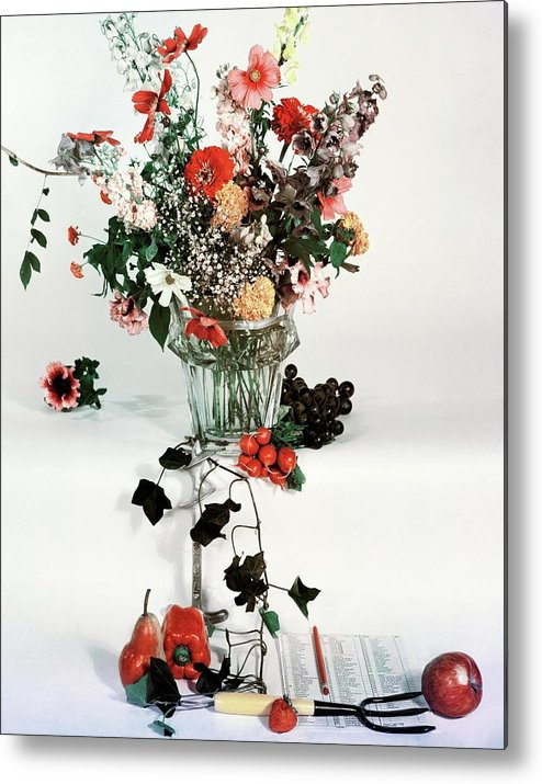 Nobody Metal Print featuring the photograph A Studio Shot Of A Vase Of Flowers And A Garden by Herbert Matter