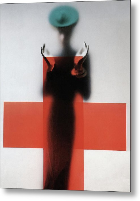 Fashion Metal Print featuring the photograph A Woman Standing Behind A Red Cross On Frosted by Erwin Blumenfeld