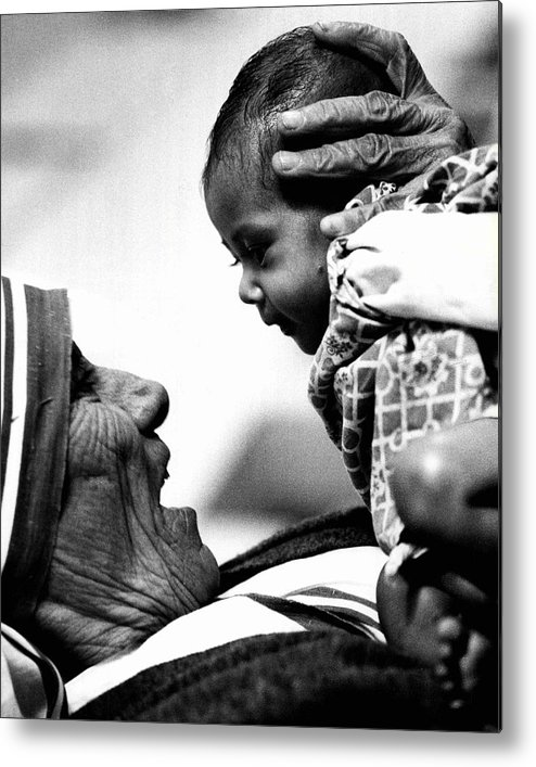 Classic Metal Print featuring the photograph Mother Teresa Holds Baby by Retro Images Archive