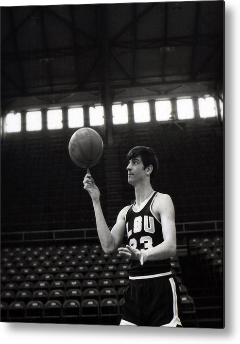 Classic Metal Print featuring the photograph Pete Maravich Spinning Ball On Finger by Retro Images Archive