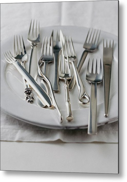 Kitchen Metal Print featuring the photograph Various Forks On A Plate by Romulo Yanes