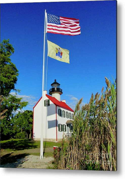 East Point Lighthouse Metal Print featuring the photograph North Wind At East Point Light by Nancy Patterson