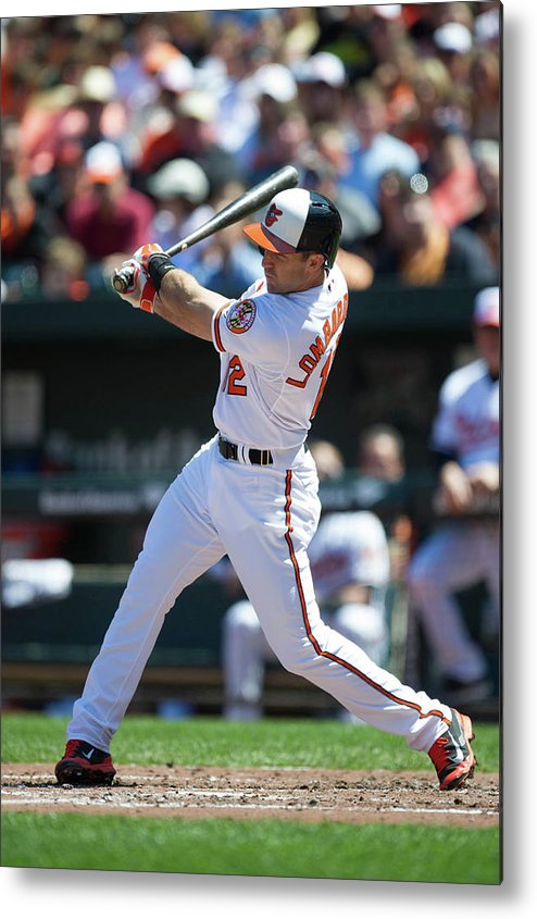 American League Baseball Metal Print featuring the photograph Kansas City Royals V Baltimore Orioles by Rob Tringali