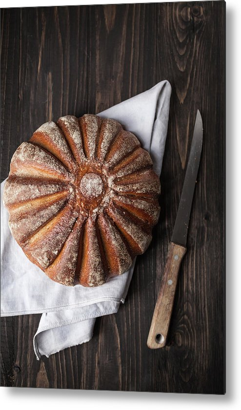 Kitchen Knife Metal Print featuring the photograph Fresh Baked Bread With Kitchen Knife On by Westend61
