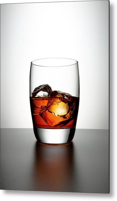 White Background Metal Print featuring the photograph Glass With Brown Liquor And Ice Cubes by Chris Stein
