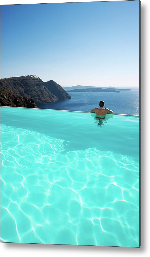 People Metal Print featuring the photograph Man Relaxing Looking At Santorini by Peskymonkey