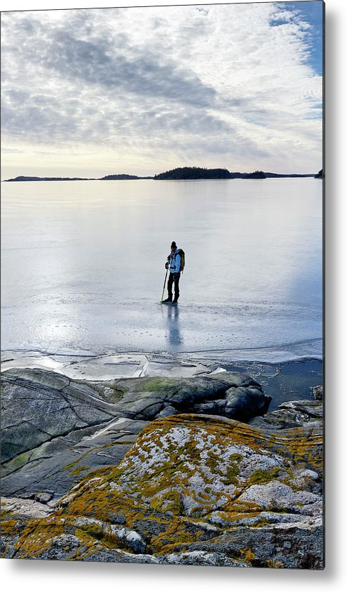 Archipelago Metal Print featuring the photograph Person Skating At Frozen Sea by Johner Images