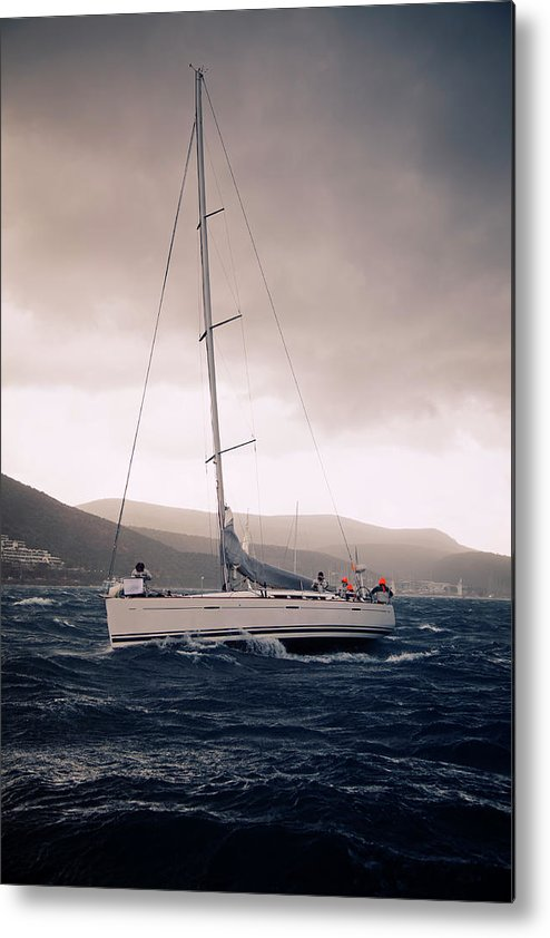 Recreational Pursuit Metal Print featuring the photograph Sailing And Stormy Weather by Travenian