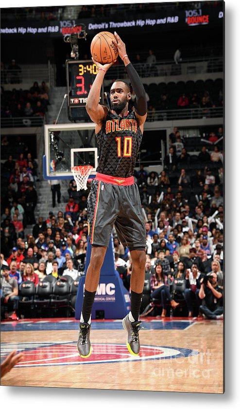 Tim Hardaway Jr. Metal Print featuring the photograph Atlanta Hawks V Detroit Pistons by Chris Schwegler