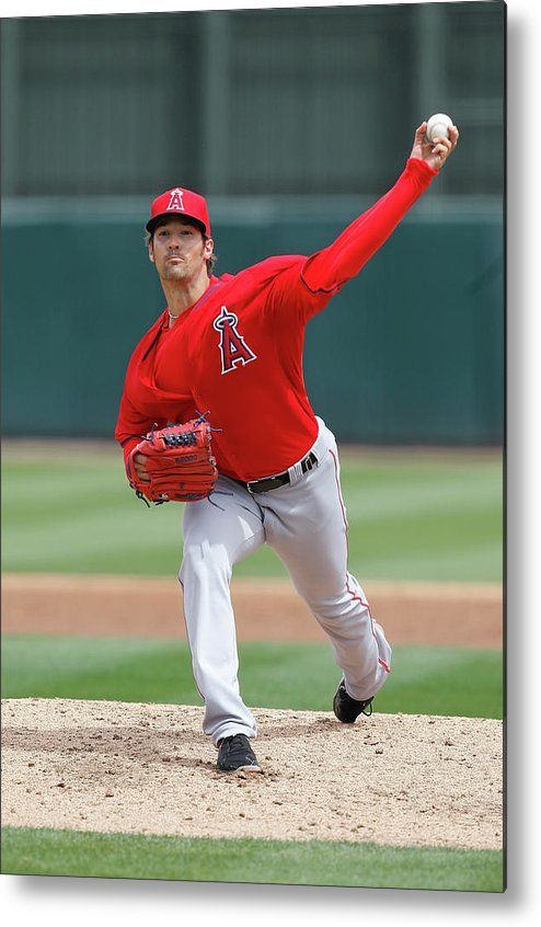 American League Baseball Metal Print featuring the photograph Los Angeles Angels Of Anaheim V Oakland by Sarah Crabill