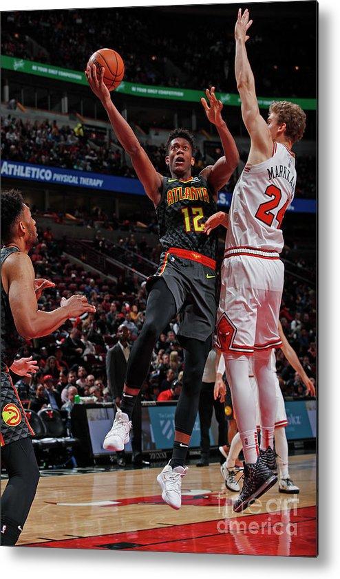 De'andre Hunter Metal Print featuring the photograph Atlanta Hawks V Chicago Bulls by Jeff Haynes
