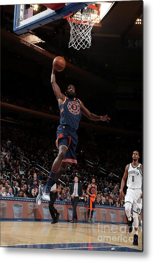 Tim Hardaway Jr. Metal Print featuring the photograph Brooklyn Nets V New York Knicks by Nathaniel S. Butler