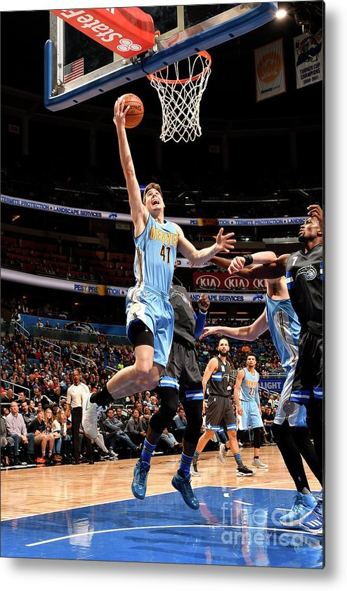 Nba Pro Basketball Metal Print featuring the photograph Denver Nuggets V Orlando Magic by Fernando Medina