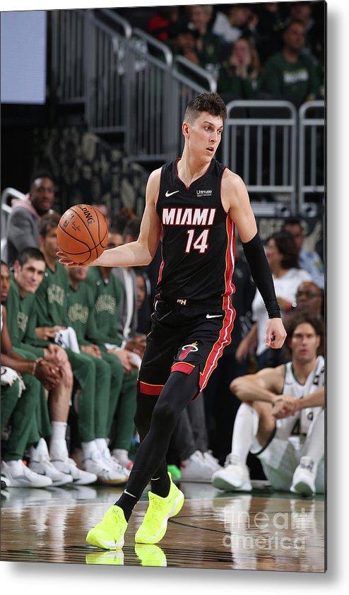 Tyler Herro Metal Print featuring the photograph Miami Heat V Milwaukee Bucks by Gary Dineen