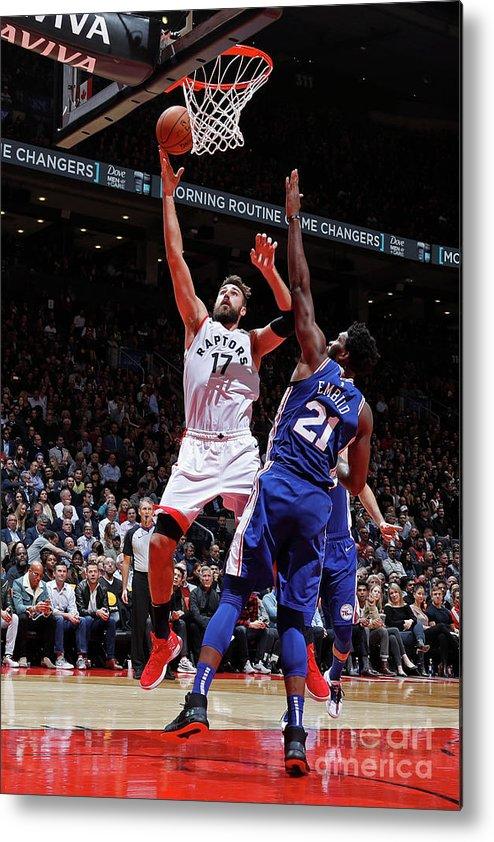 Nba Pro Basketball Metal Print featuring the photograph Philadelphia 76ers V Toronto Raptors by Mark Blinch