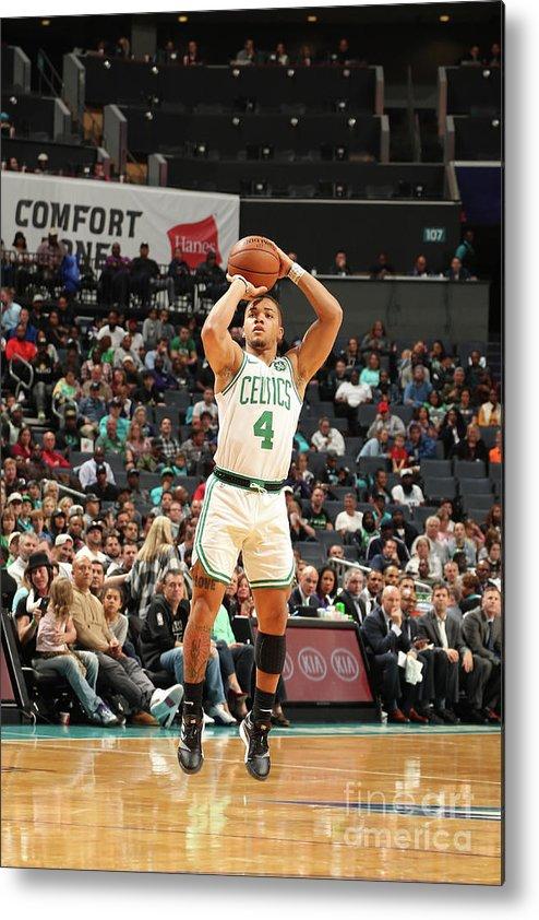 Nba Pro Basketball Metal Print featuring the photograph Boston Celtics V Charlotte Hornets by Kent Smith