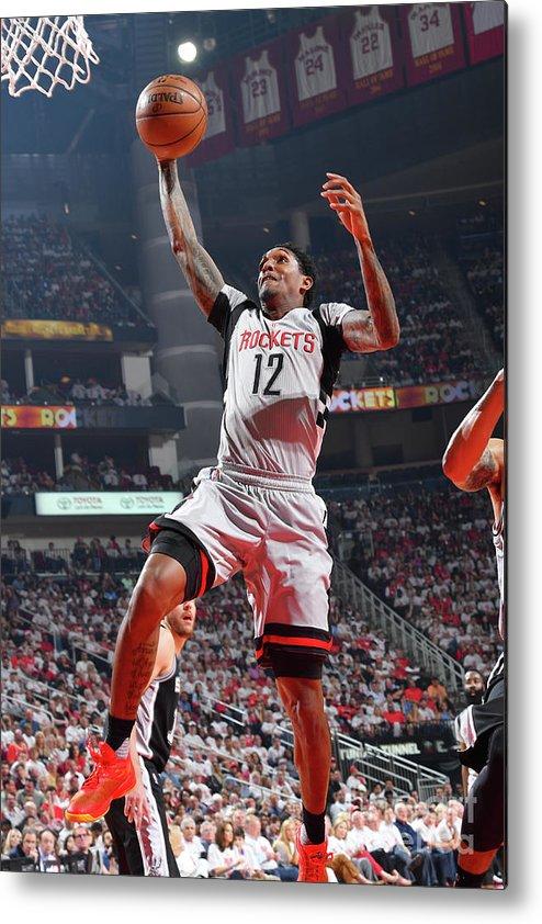 Playoffs Metal Print featuring the photograph San Antonio Spurs V Houston Rockets - by Jesse D. Garrabrant