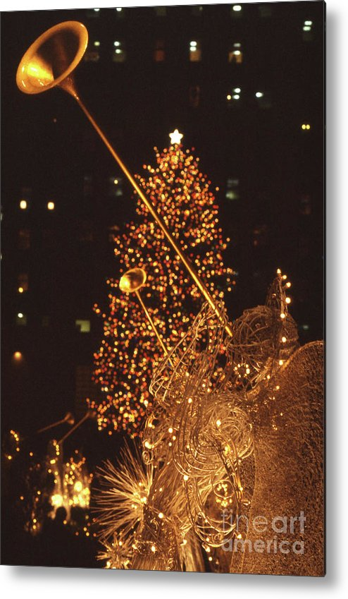 1980-1989 Metal Print featuring the photograph Christmas Tree At Rockefeller Center by Bettmann