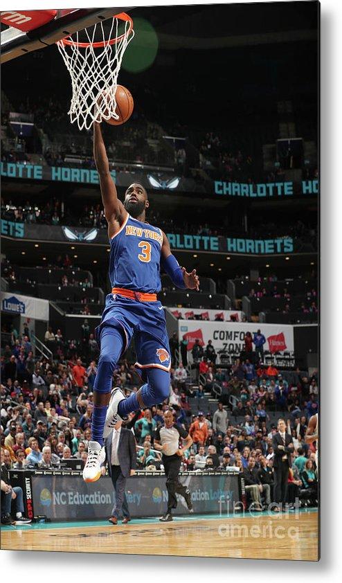 Tim Hardaway Jr. Metal Print featuring the photograph New York Knicks V Charlotte Hornets by Kent Smith