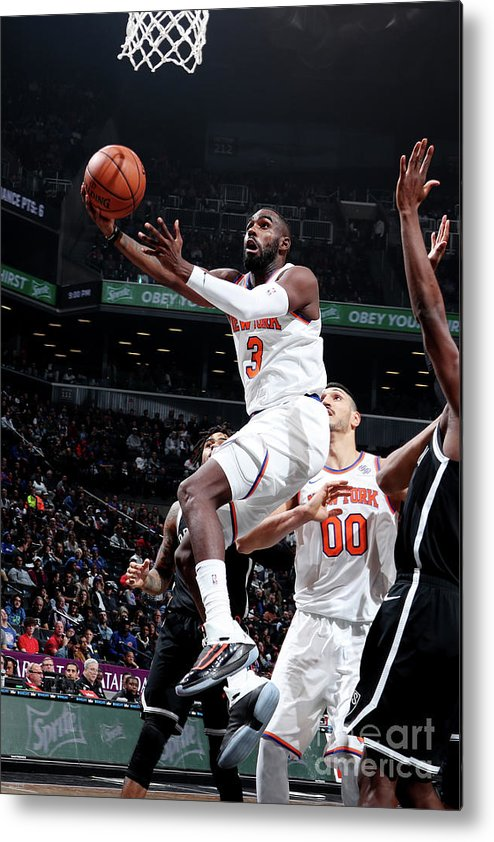 Tim Hardaway Jr. Metal Print featuring the photograph New York Knicks V Brooklyn Nets by Nathaniel S. Butler