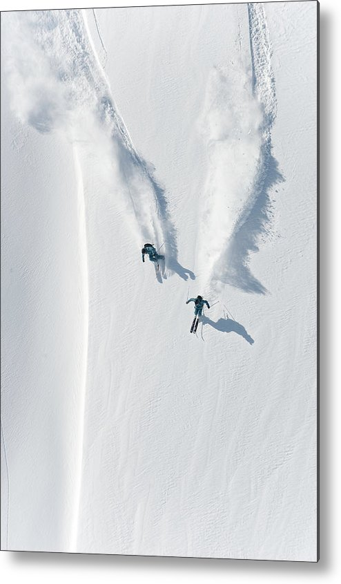 Crash Helmet Metal Print featuring the photograph Aerial View Of Two Skiers Skiing by Creativaimage