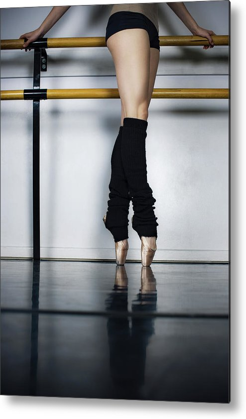 Ballet Dancer Metal Print featuring the photograph Ballet Holdiing Bar In Classic Pointe by Patrik Giardino