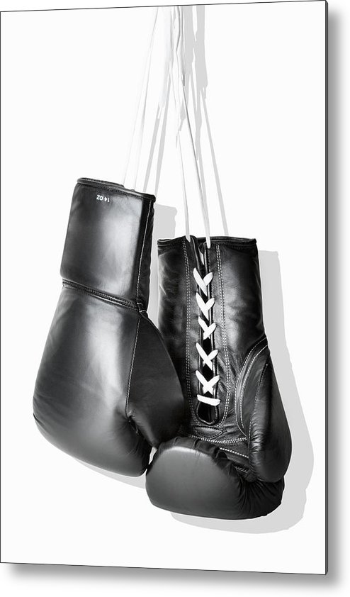 Hanging Metal Print featuring the photograph Boxing Gloves Hanging Against White by Burazin