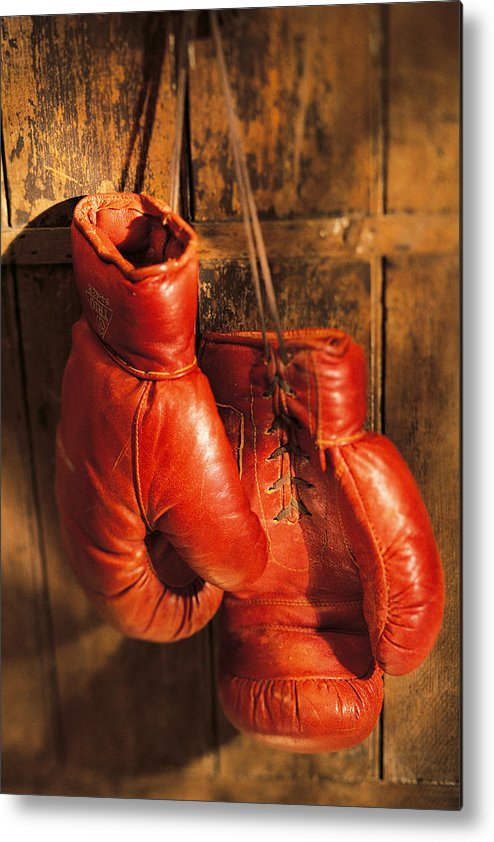 Hanging Metal Print featuring the photograph Boxing Gloves Hanging On Rustic Wooden by Comstock