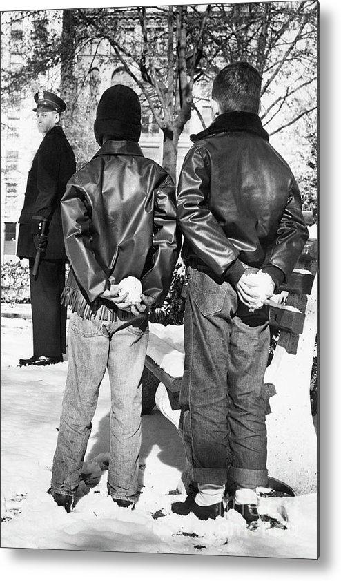 The End Metal Print featuring the photograph Boys Hiding Snowballs Behind Their Backs by Bettmann