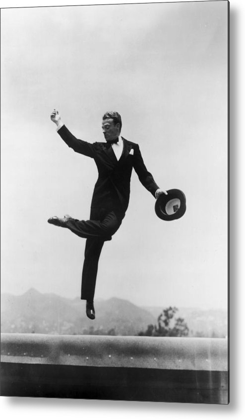 Wind Metal Print featuring the photograph Cagney Leaping In Formal Attire by Getty Images