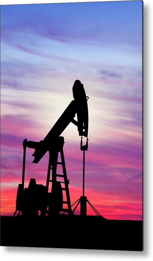 Dawn Metal Print featuring the photograph Dawn Over Gasoline Pump by Grafissimo