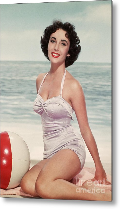 People Metal Print featuring the photograph Elizabeth Taylor In A Bathing Suit by Bettmann