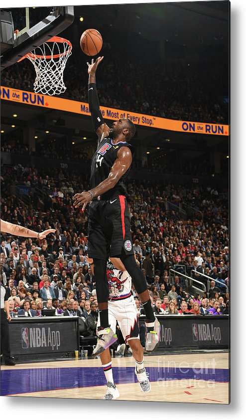 Patrick Patterson Metal Print featuring the photograph La Clippers V Toronto Raptors by Ron Turenne