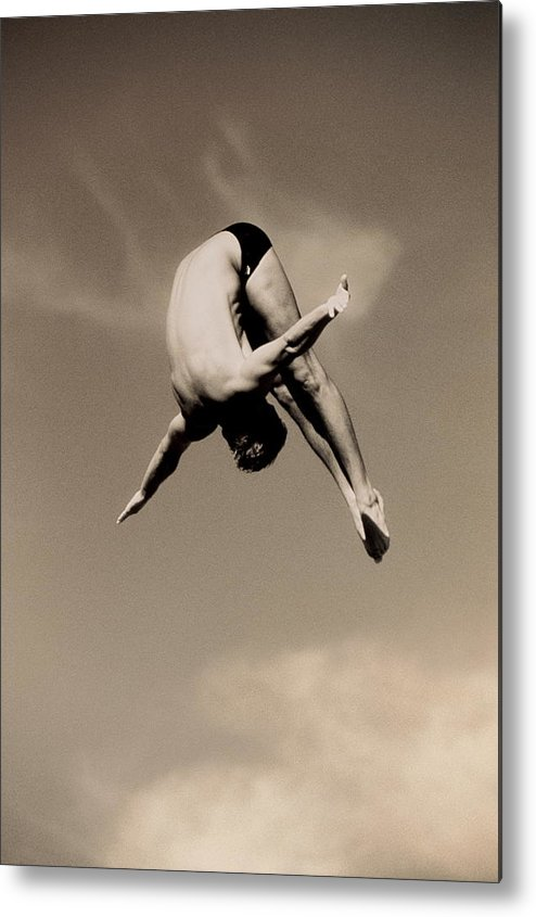 Diving Into Water Metal Print featuring the photograph Male Diver In Mid-air by David Madison