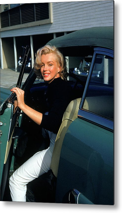 Marilyn Monroe Metal Print featuring the photograph Marilyn Monroe Getting Out Of A Car by Alfred Eisenstaedt
